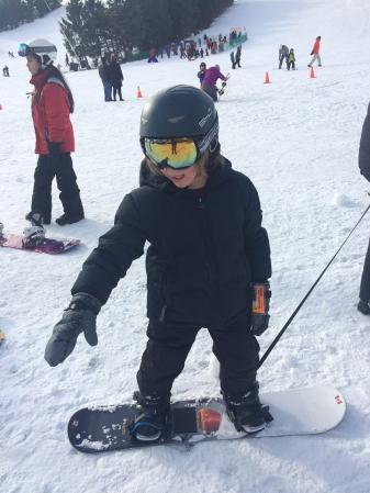 sullivan on a leash snowboarding